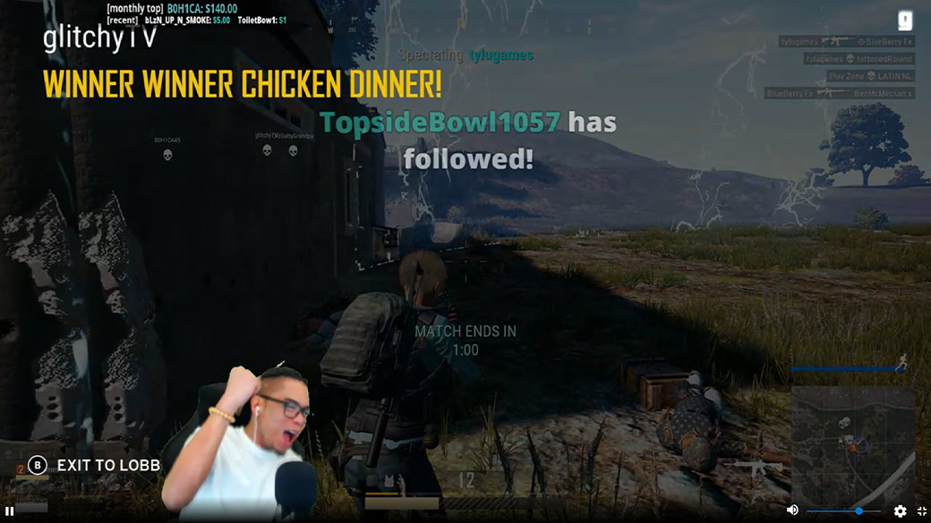 shot of Glitchy fist pumping with PLAYERUNKNOWN'S BATTLEGROUNDS screen in background