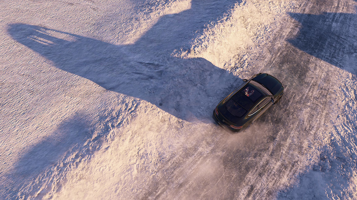 Top down view of a Mercedes driving on a snow covered race track