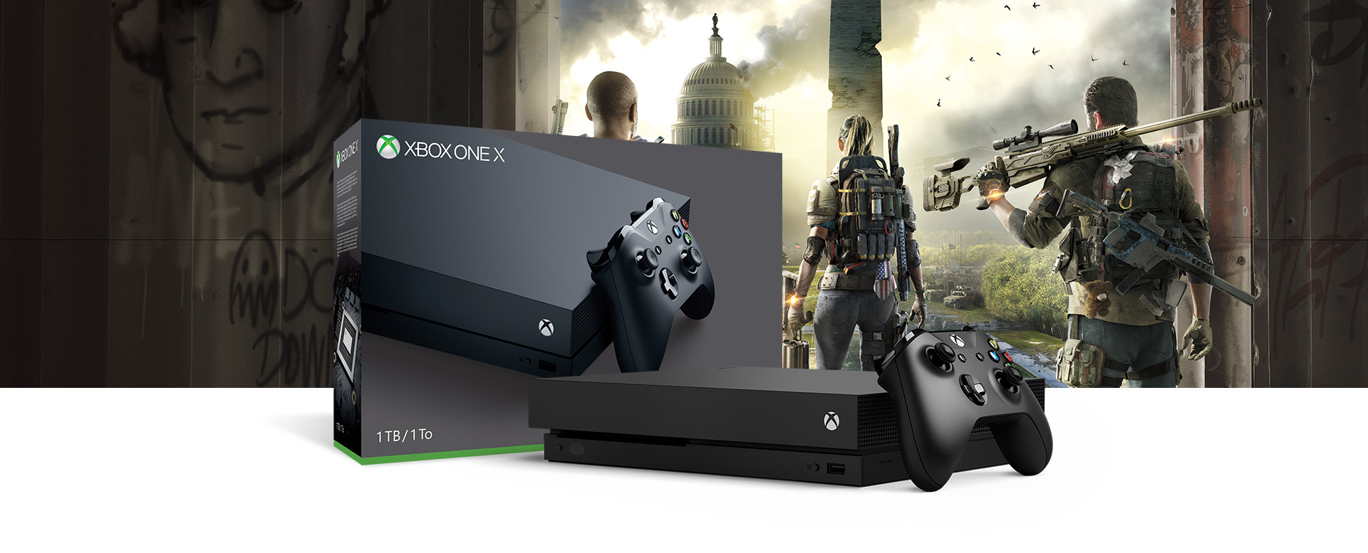 Xbox One X console in front of a hardware bundle box featuring Tom Clancy's The Division 2 art