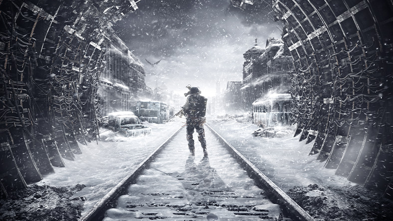 Metro Exodus. A man holding a gun stands on snow covered tracks in a tunnel