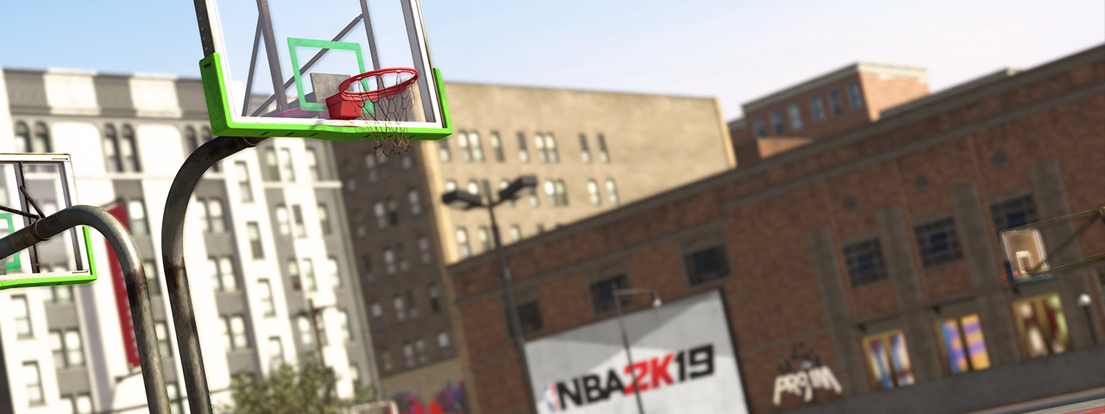 Side view of a basketball hoop on a basketball court in a city