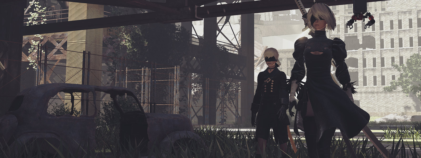 2B and 9S walk under a bridge next to a run-down car