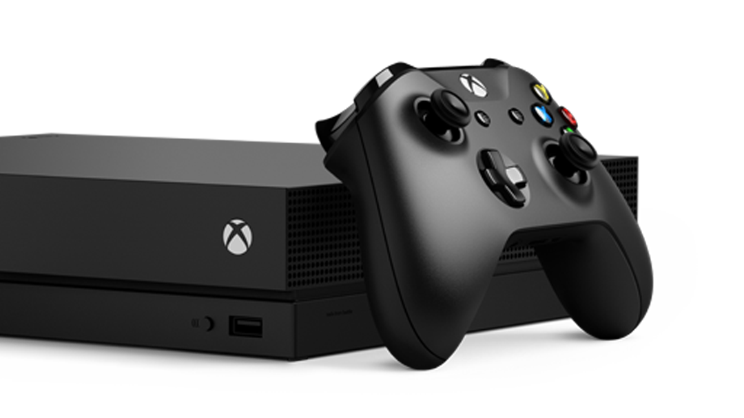 xbox one x console and an xbox controller