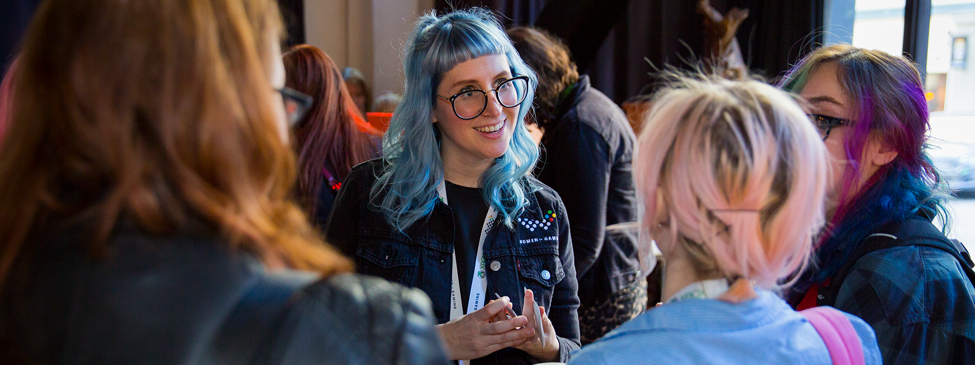 Women from the gaming industry attend a community event