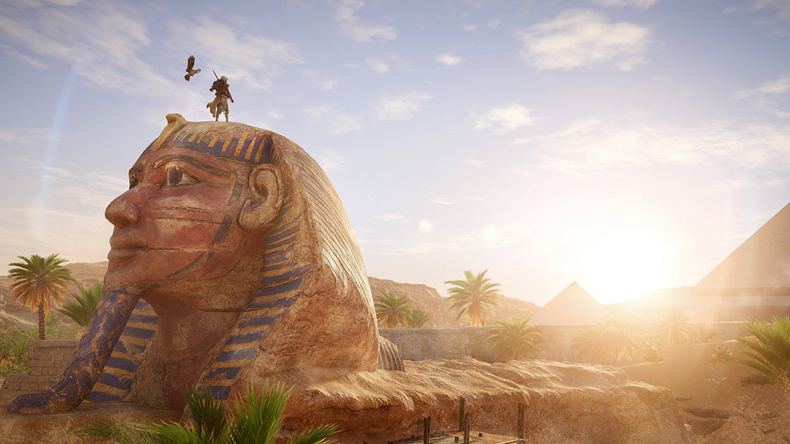 Back view of Bayek standing on the Sphinx in Egypt