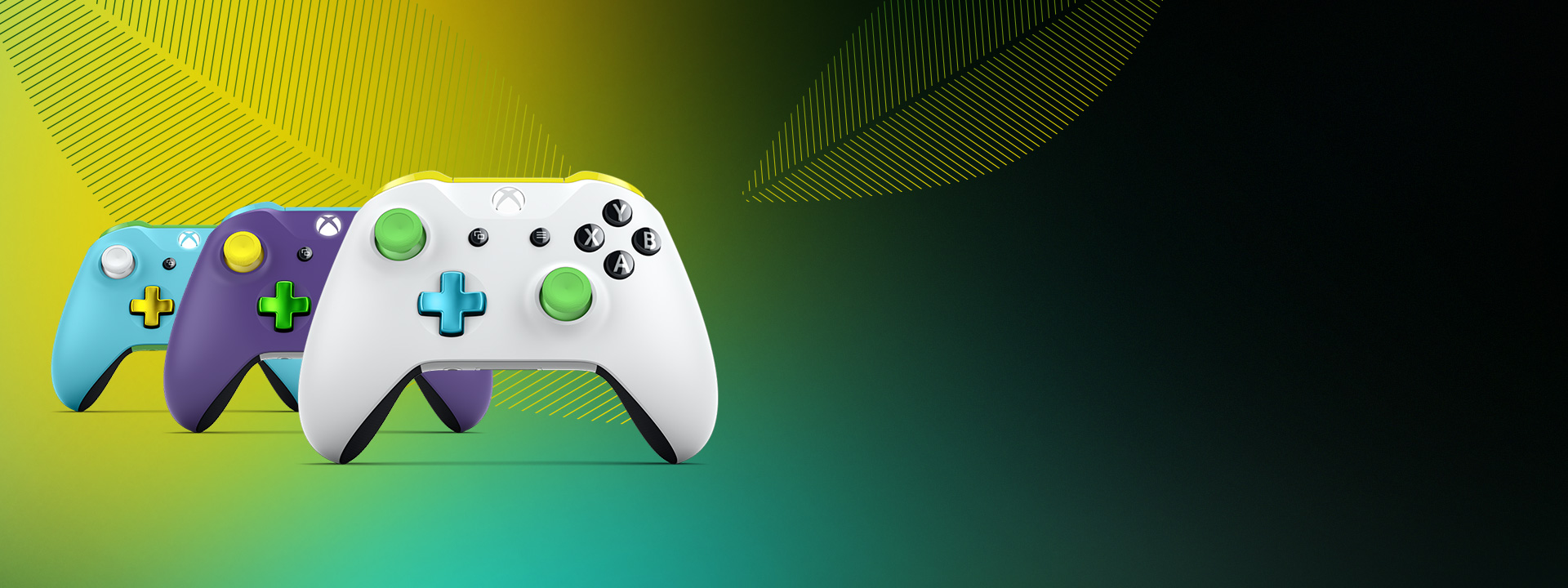 Three custom Xbox Design Lab controllers among abstract spring leaves