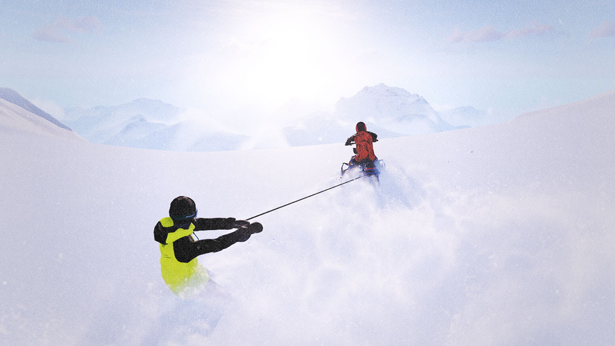 A snow mobile tows a snowboarder up a powder covered mountain.