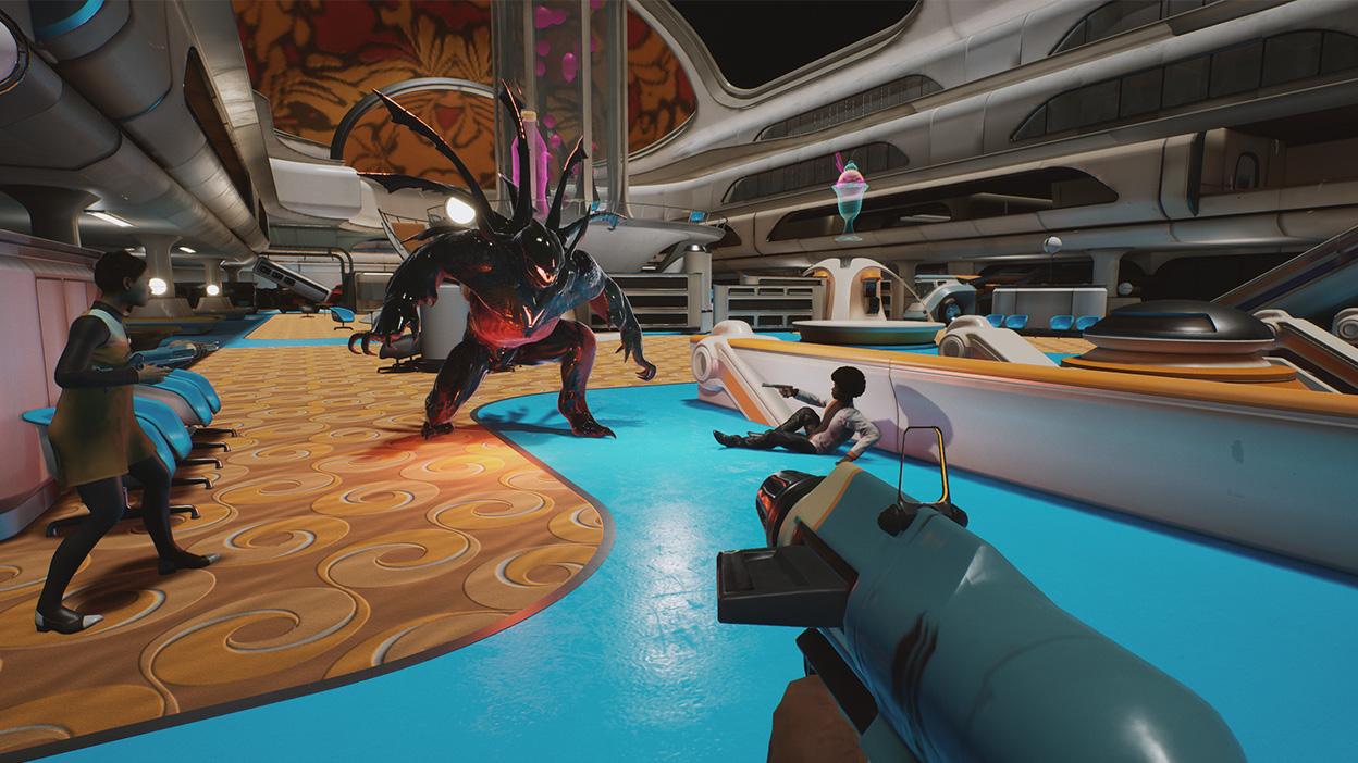 Ein Team kämpft in einem großen offenen Raum auf einem Raumschiff gegen ein riesiges Monster.
