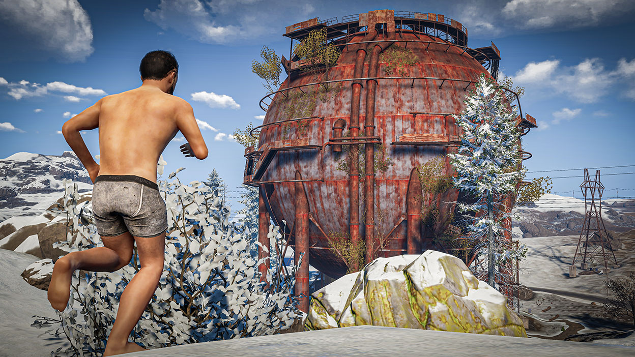 Character in underwear running in the snow towards a water tower