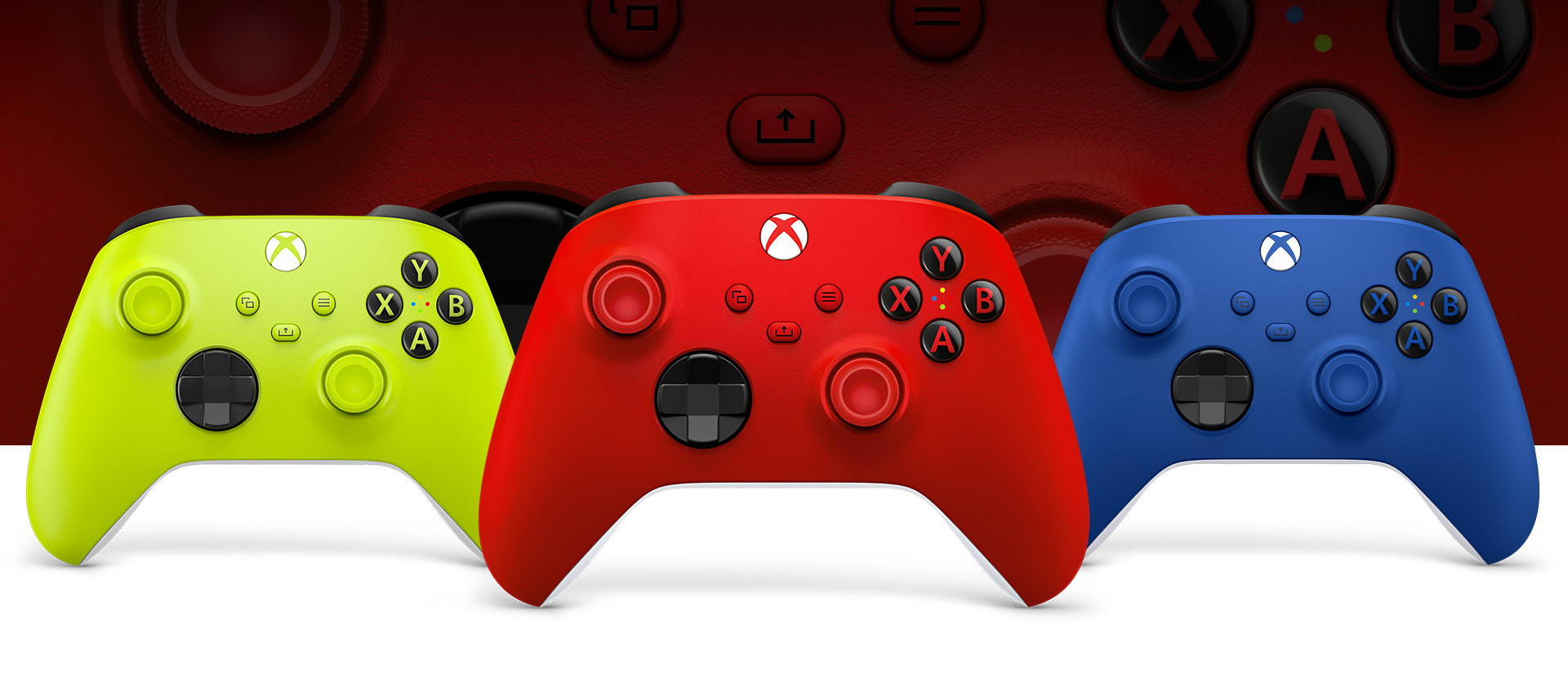 Xbox Pulse Red controller in front with the Electric Volt and Shock Blue controllers beside it.