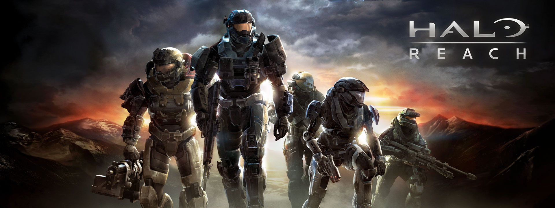 Halo Reach, a group of Halo soldiers climb a misty hill with sun breaking through heavy clouds behind them