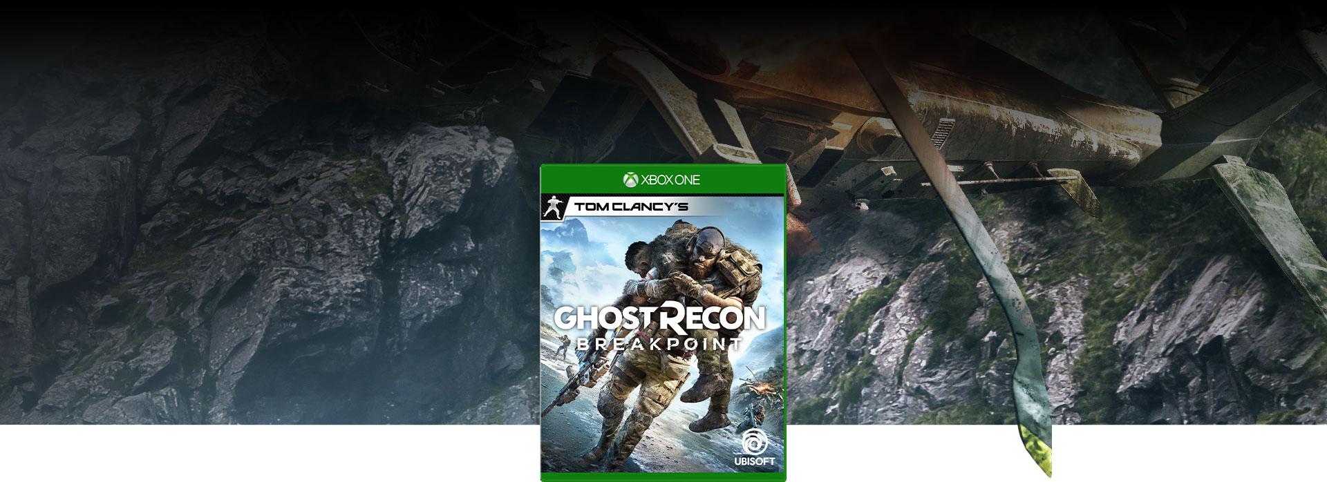 Opakowanie gry Tom Clancy's Ghost Recon Breakpoint, w tle rozbity w górach helikopter