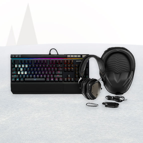 Multicolored PC keyboard with headphones in the snow