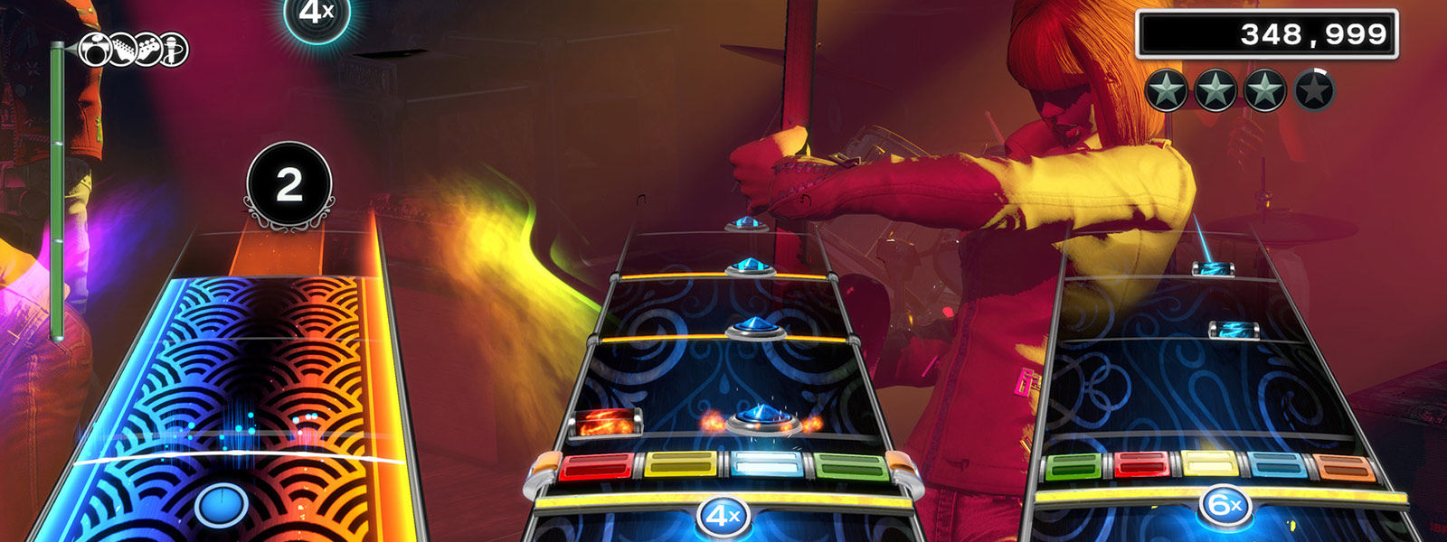 Gameplay screenshot of guitar, drums, and bass playing a song