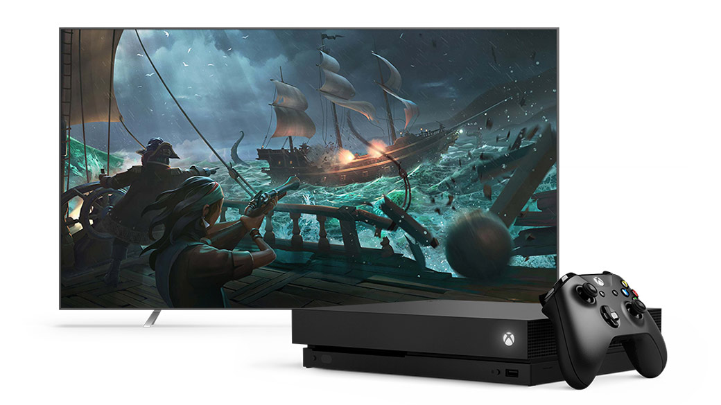 Front view Xbox One X and Xbox Wireless Controller infront of a TV playing Sea of Thieves