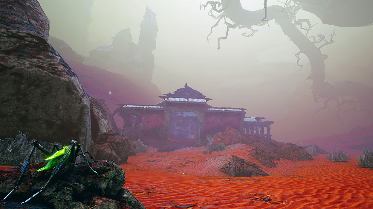 An old derelict building in a foggy, red landscape.