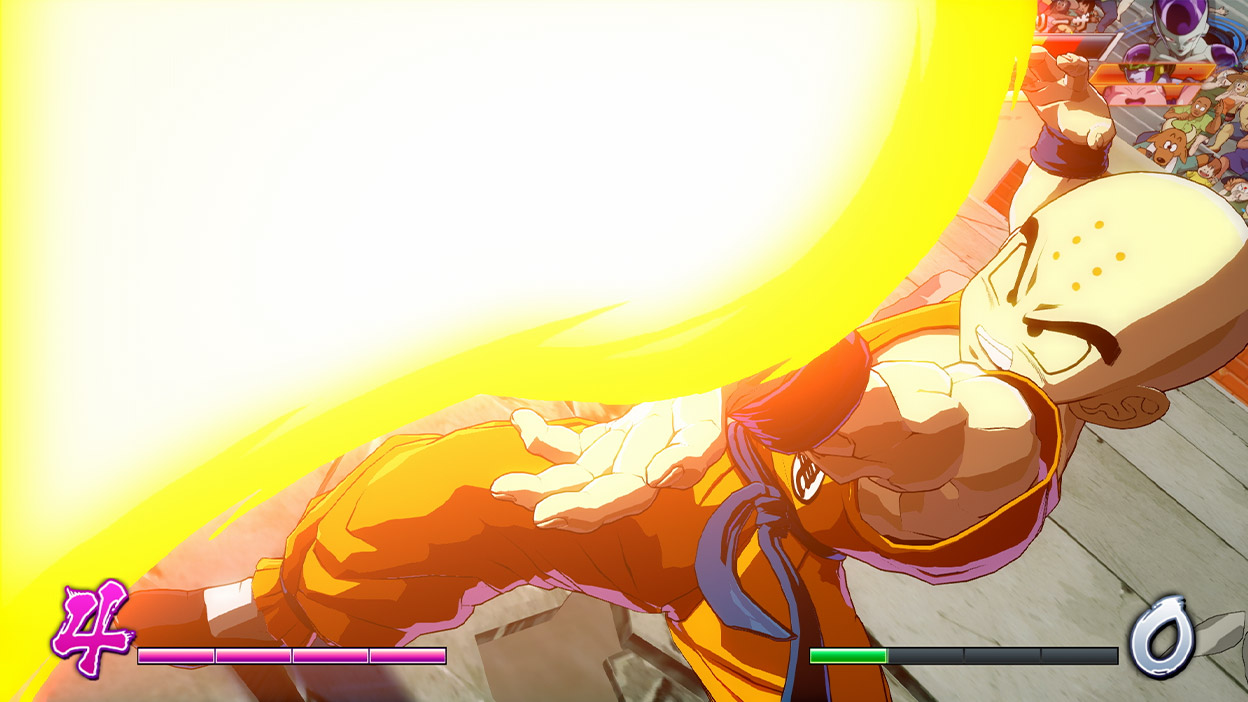 Krillin shoots a beam of fire into the air.