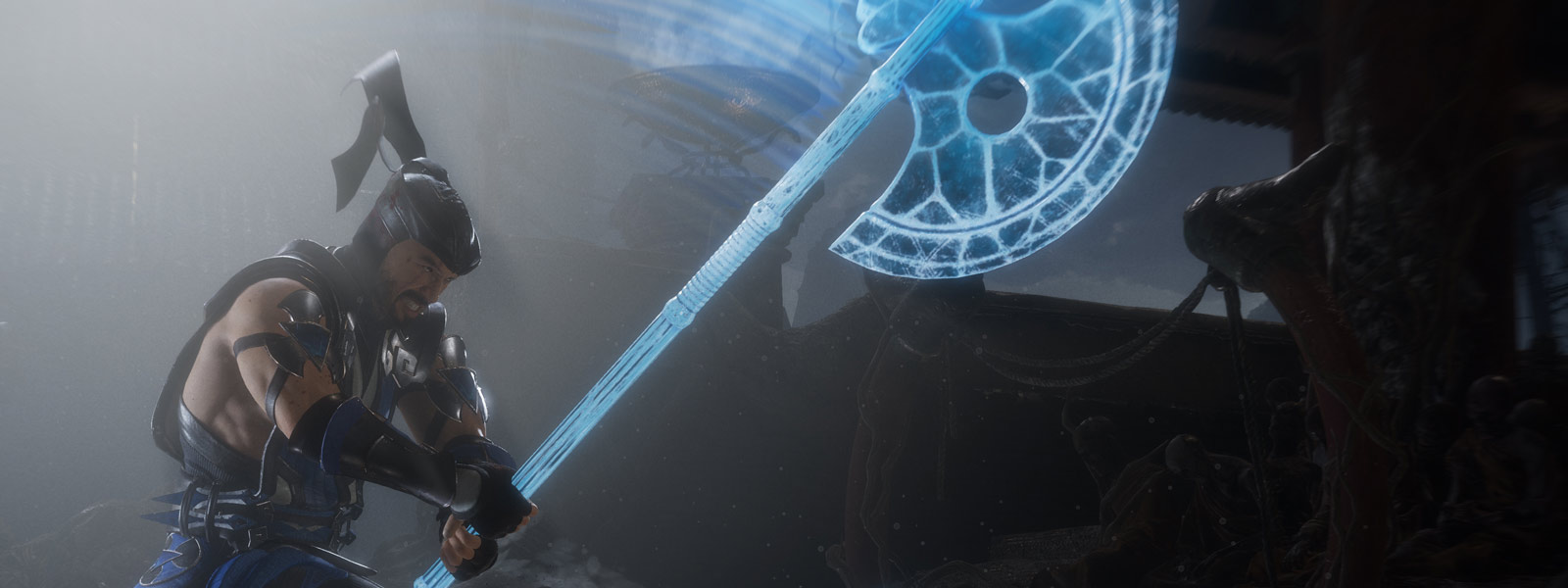Sub-Zero wields a large axe made of ice and swings downward