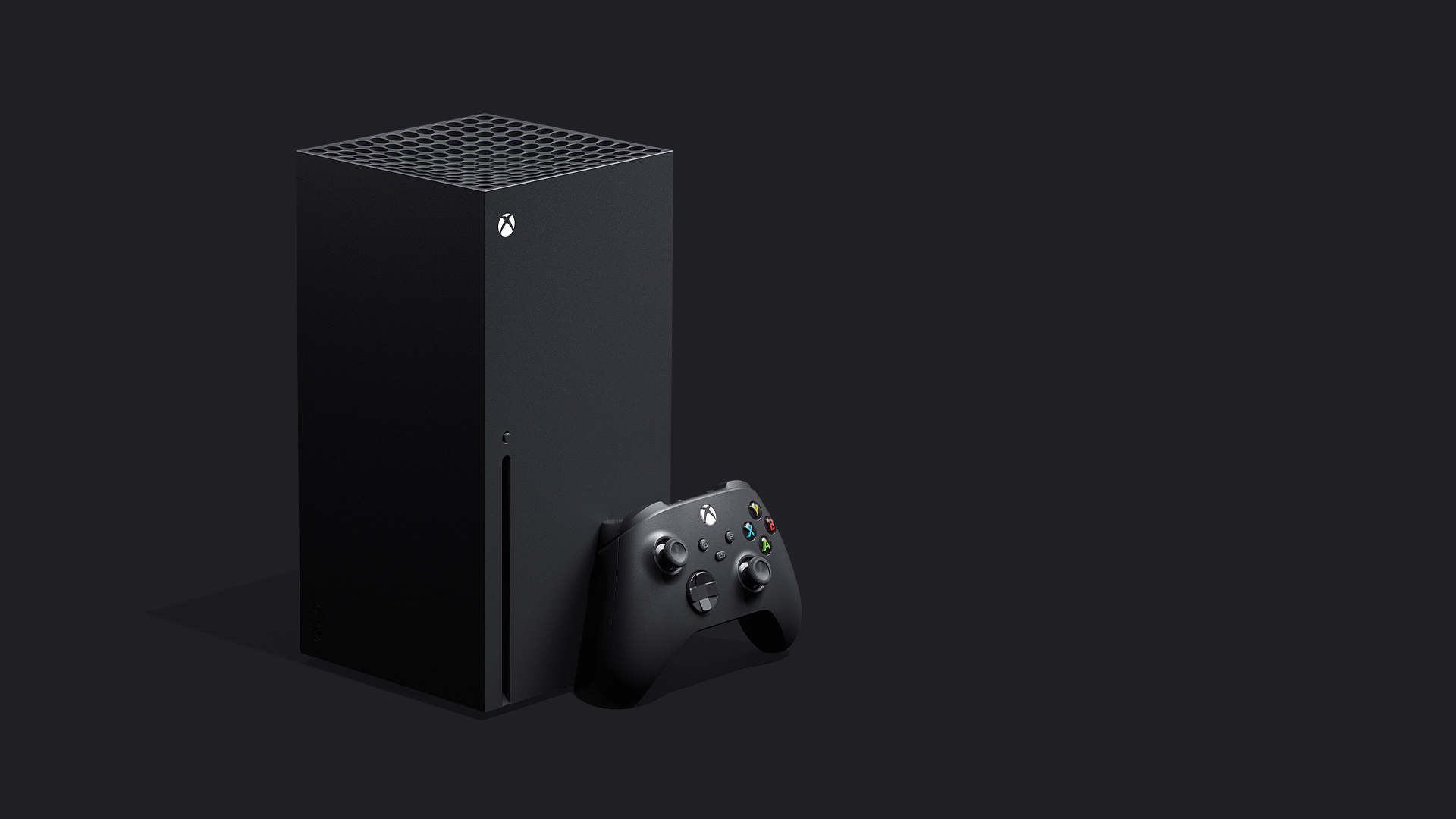Xbox Series X with a controller on a grey background