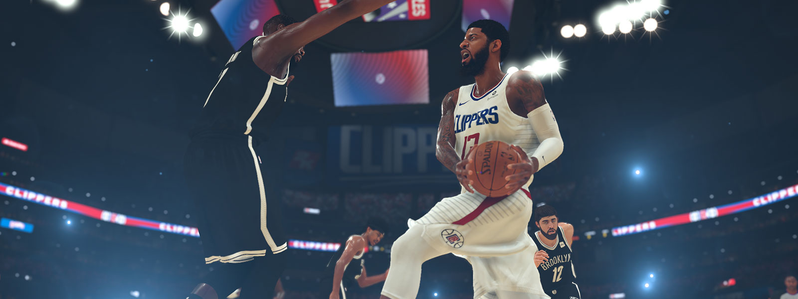 Clippers player with basketball going against a Brooklyn player