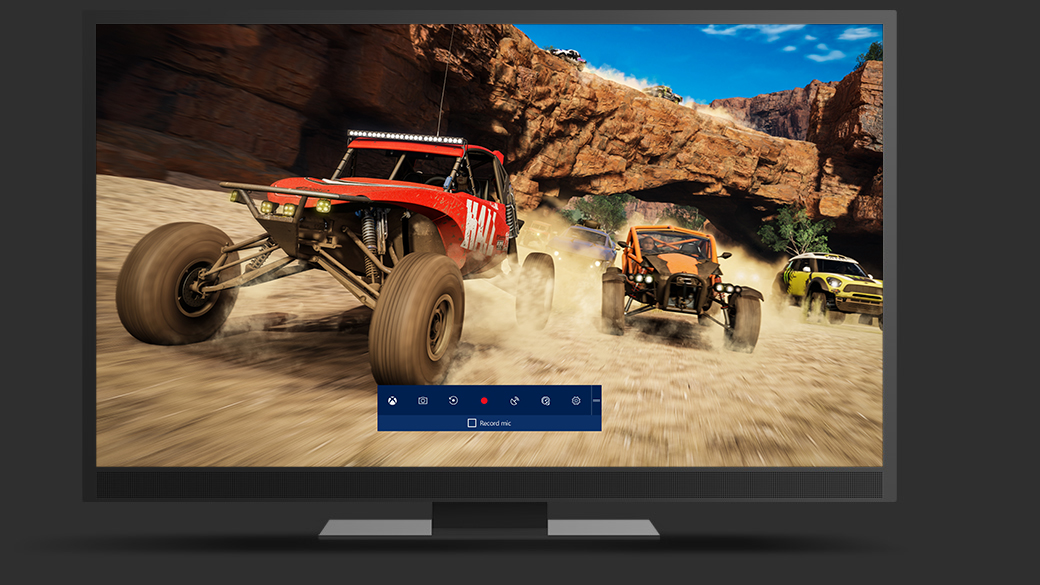 TV with recorded game play footage of a Forza race in the desert