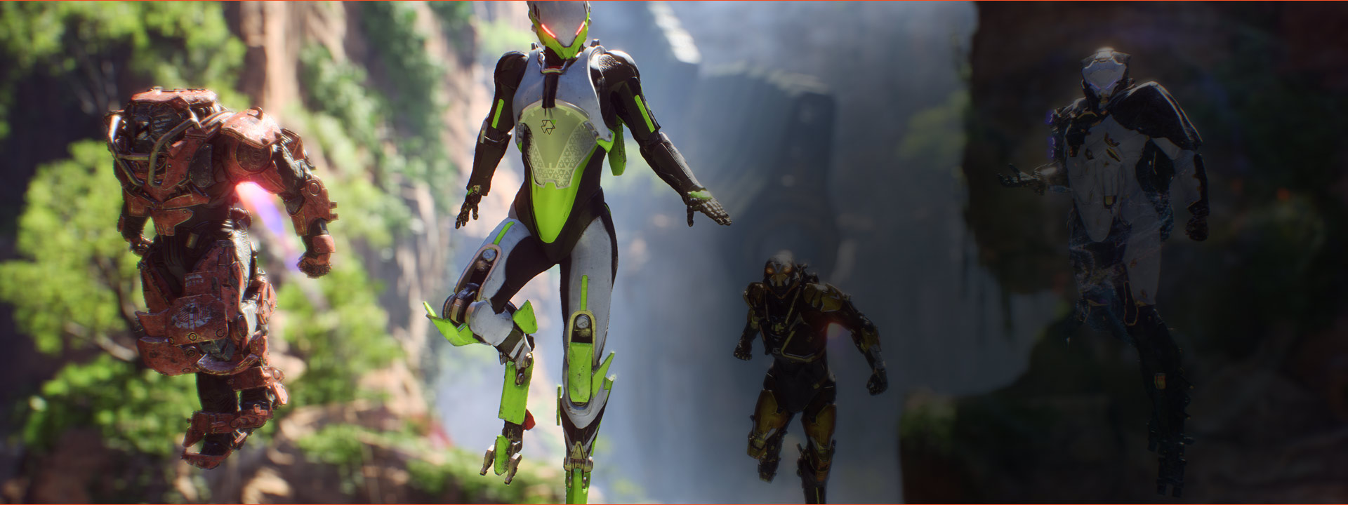 Four different exosuits hover between a canyon