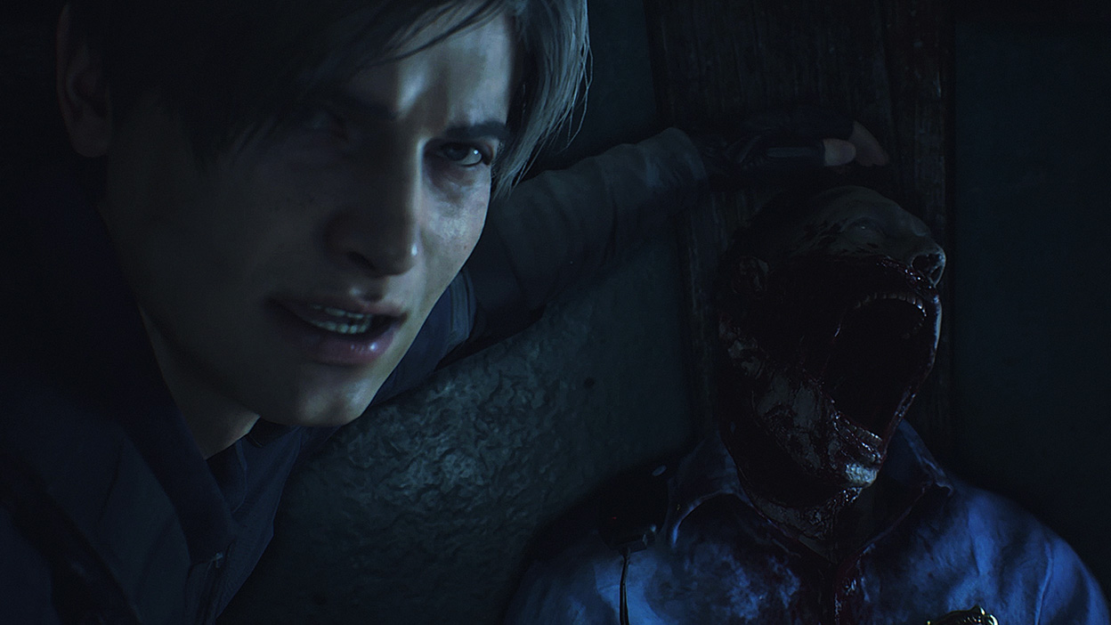 Leon Kennedy looks towards the camera as his hand rests above a dead zombie's head