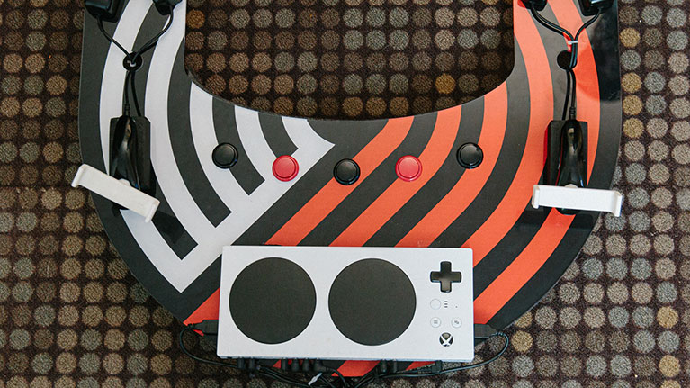 Xbox adaptive controller on a custom gaming setup.