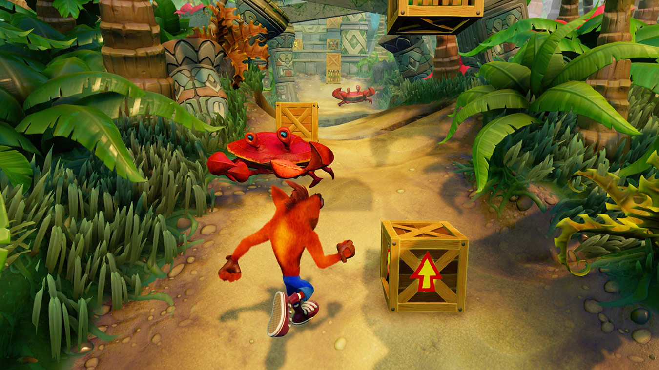 Gameplay of Crash dodging a large crab on a path in a jungle