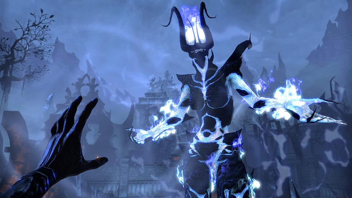 In first person, playable character holds their hand out to cast a spell on a blue Flame Atronach