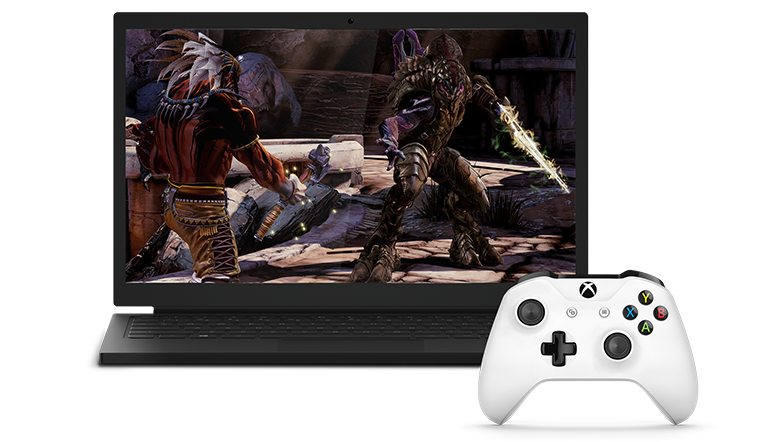 Laptop showing a video game next to a White Xbox Wireless Controller