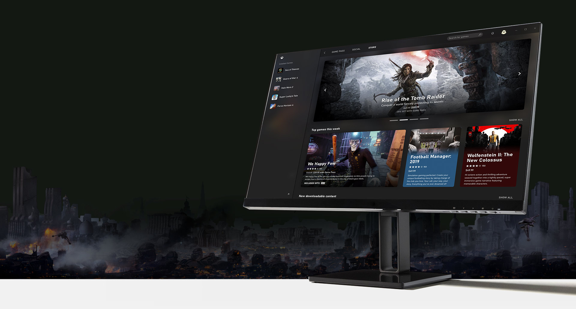 Monitor de computador com a interface do usuário do aplicativo para PC do Xbox Game Pass exibido