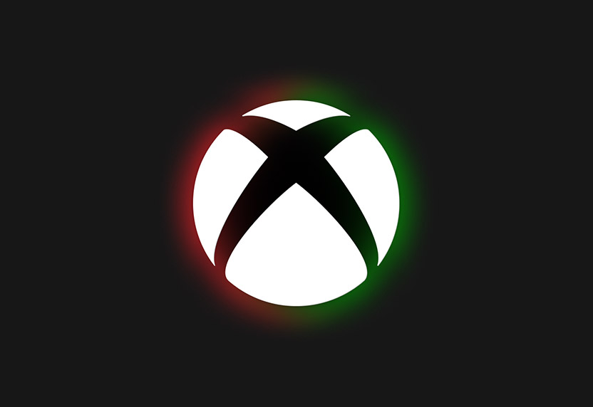 The colors of Black History Month glow behind the Xbox logo.