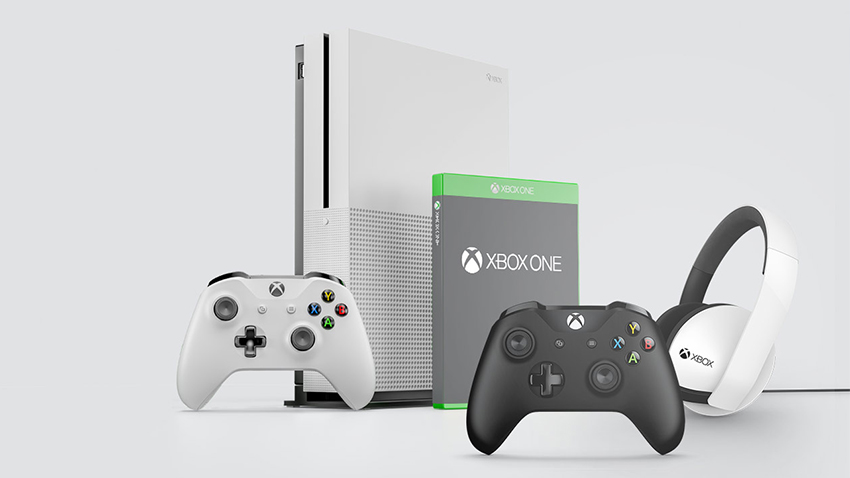 A white Xbox One S surrounded by Xbox One accessories