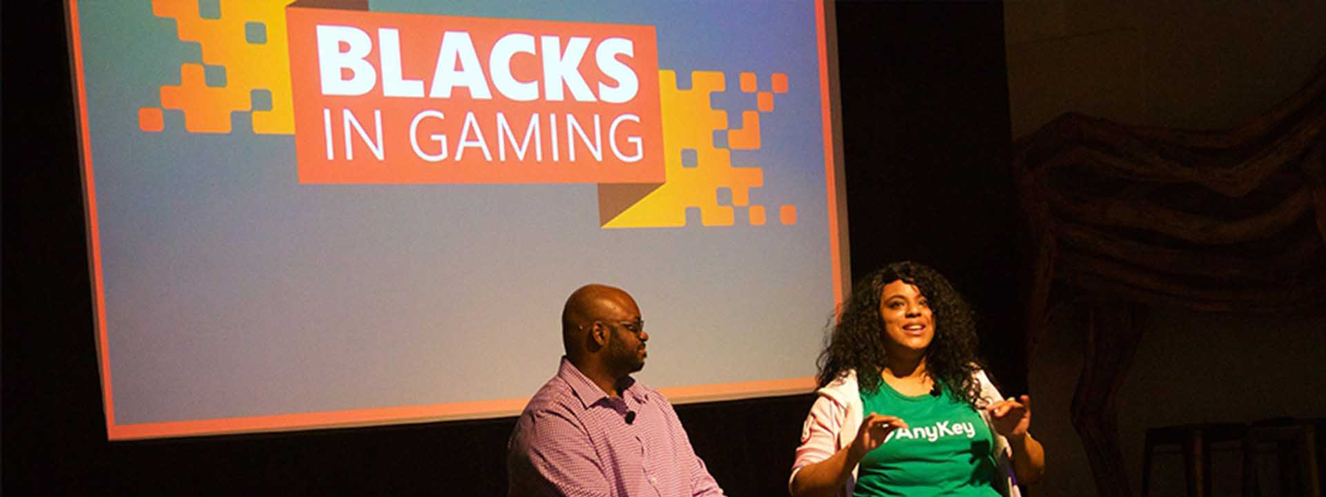 two gaming industry professionals from the black community talk on a stage
