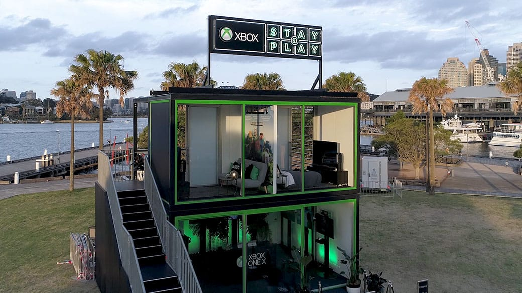 Xbox Stay and Play booth featuring rooms to hang out and play Xbox next to the water
