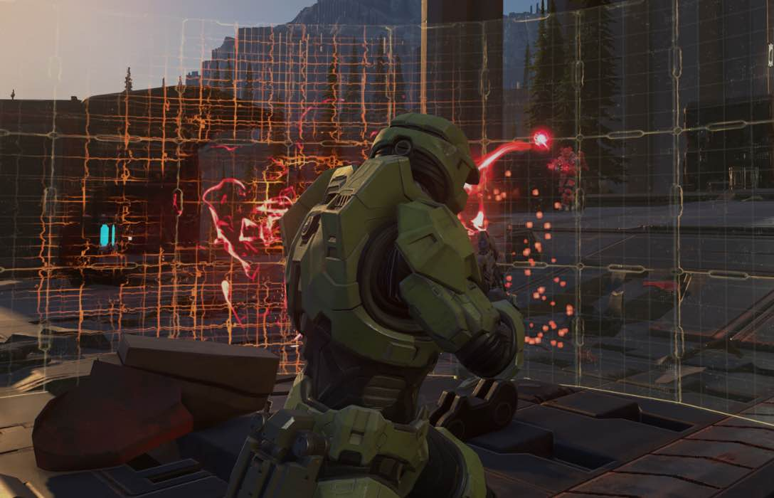 Master Chief shooting at a shield