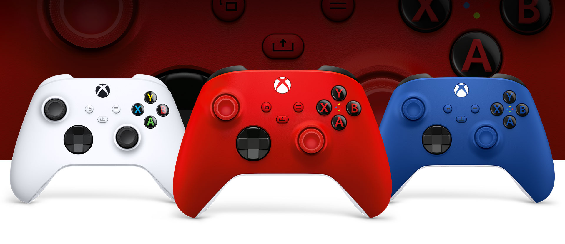 Xbox Pulse Red controller in front with the Robot White and Shock Blue controllers beside it.