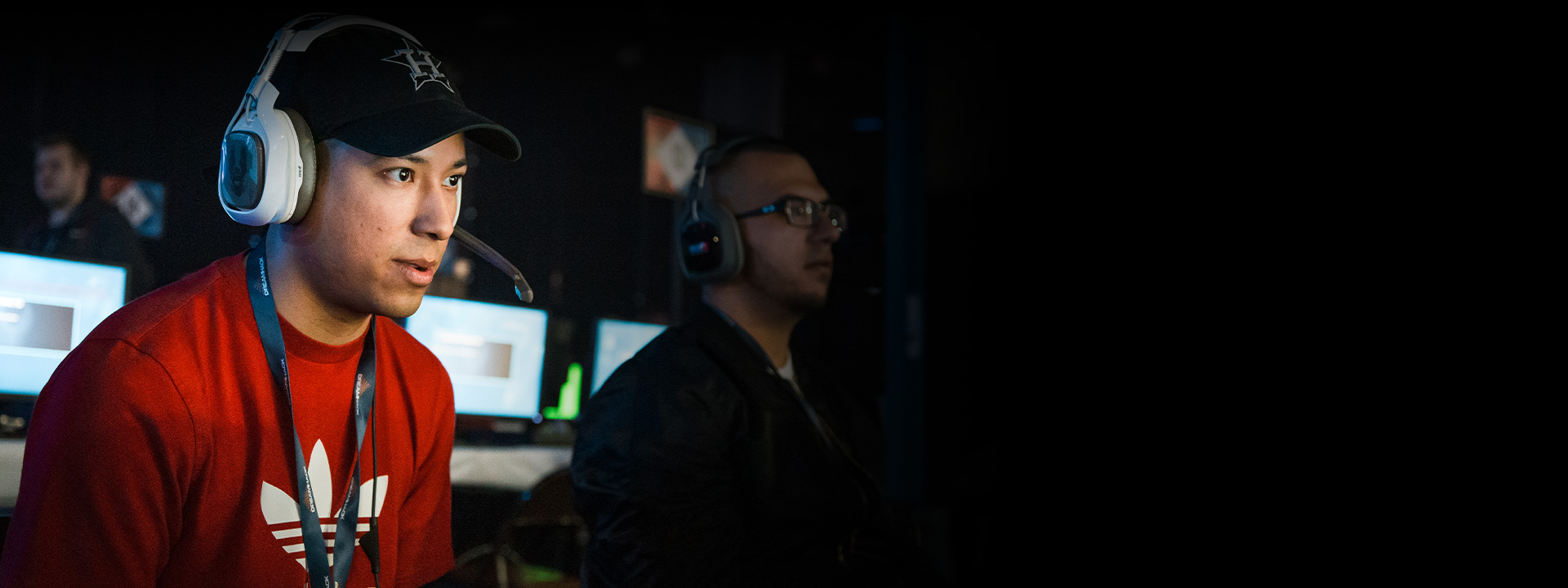 Two gamers competing at an esports event