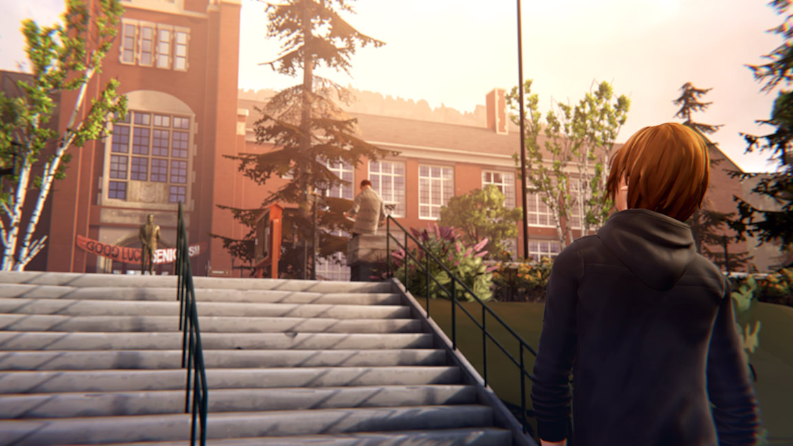 chloe looking up at the entrance to her school