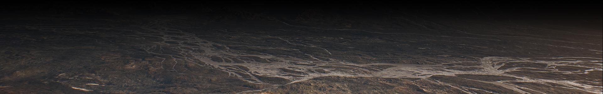 Topp ned utsikt over en dal ved foten av et fjell