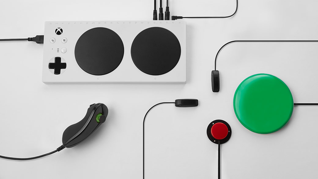 Top down view of the Xbox Adaptive Controller with added accessories connected to the controller