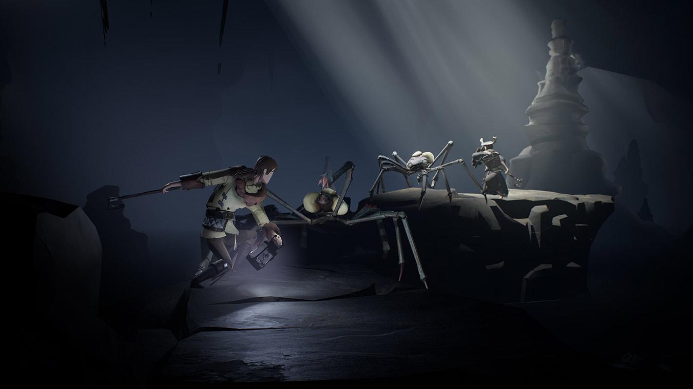 Dos personajes se pelean contra arañas gigantes en una cueva