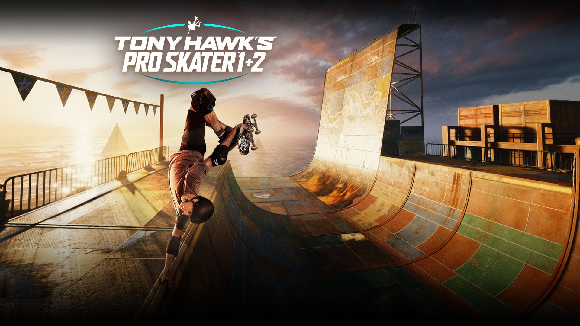 Tony Hawk's Pro Skater 1 + 2, Tony Hawk hace un truco de skate en un medio tubo junto a un océano iluminado por el sol.