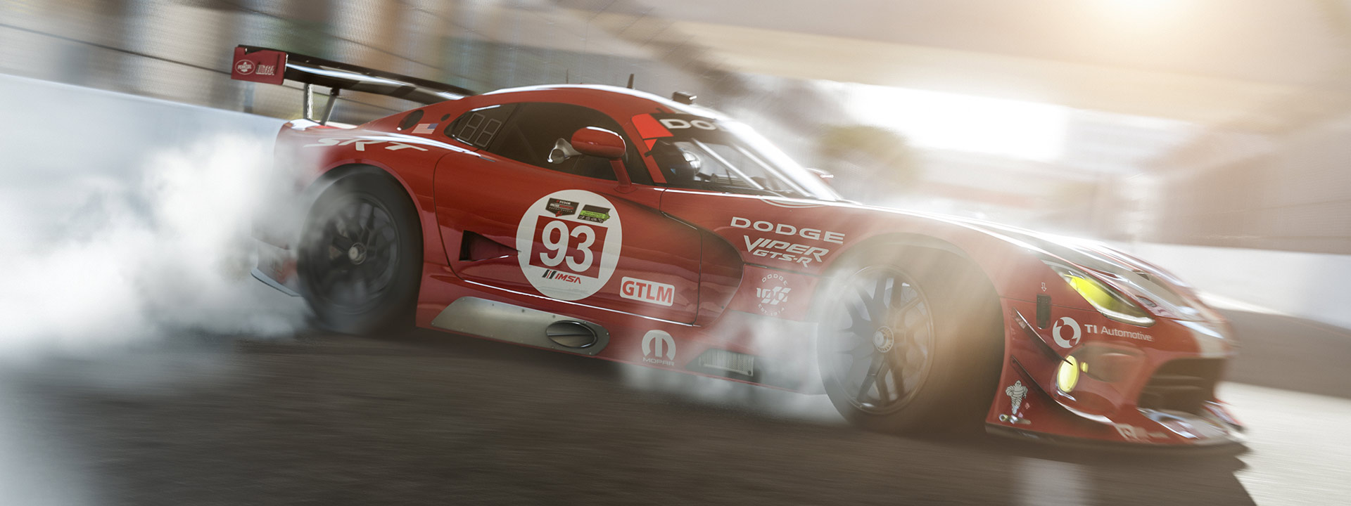 Side view of a red Dodge Viper GTS making smoke by spinning out