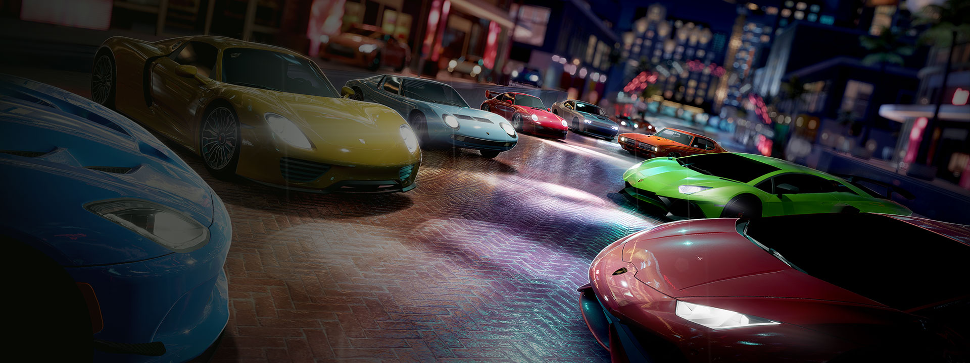 Lineup of sports cars on a colorful street at night