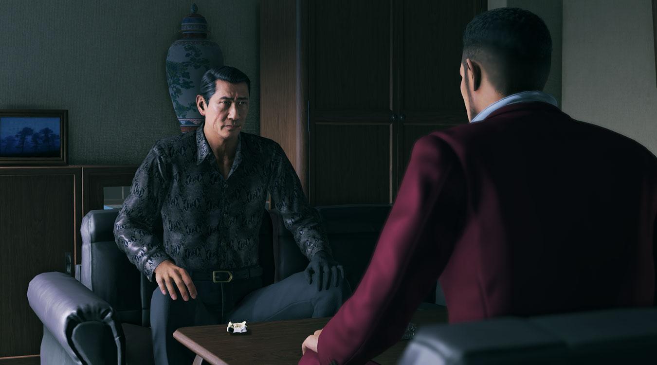 Two men talk somberly in Yakuza Like a Dragon