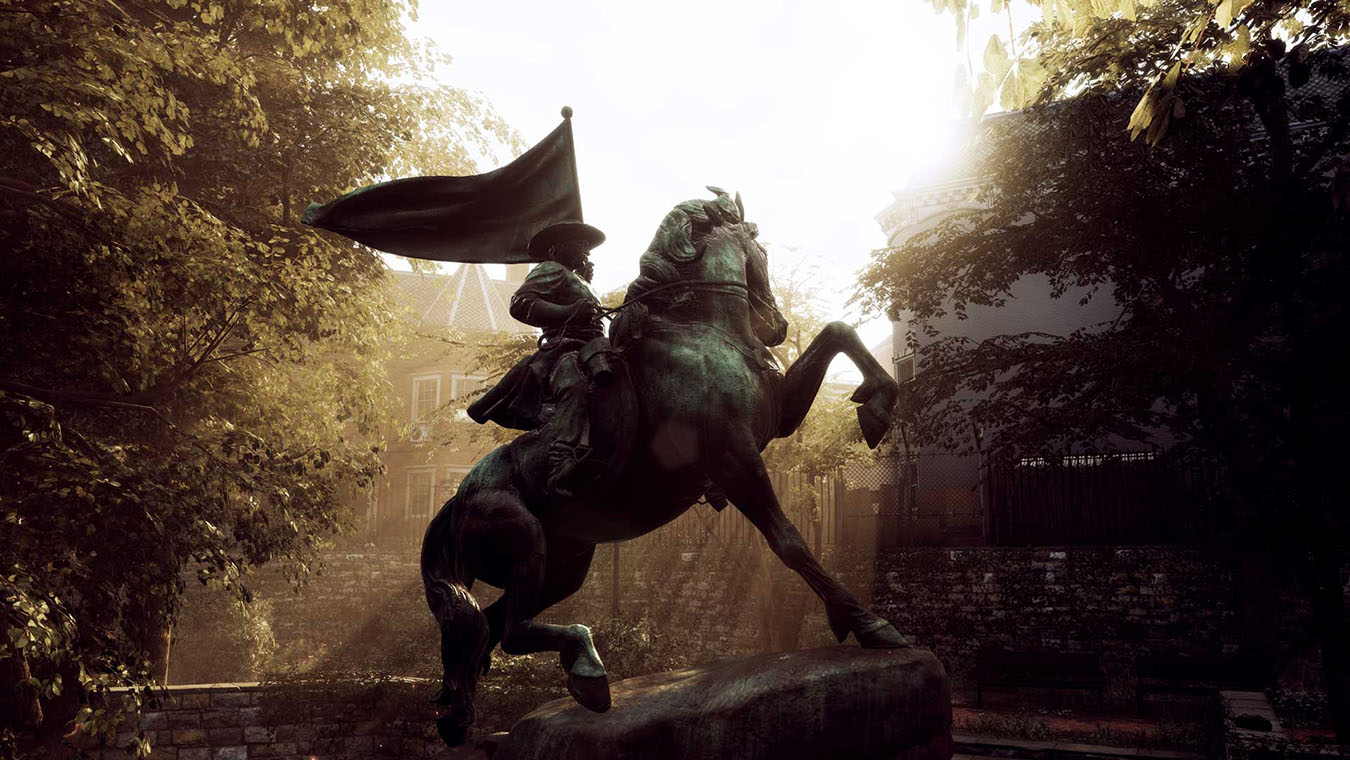A large sculpture of a man riding a horse in a garden
