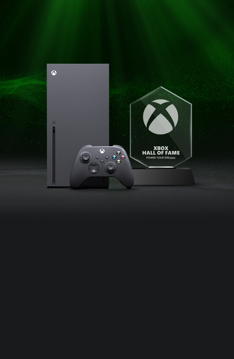 An Xbox Series X next to a sleek Xbox Hall of Fame trophy.