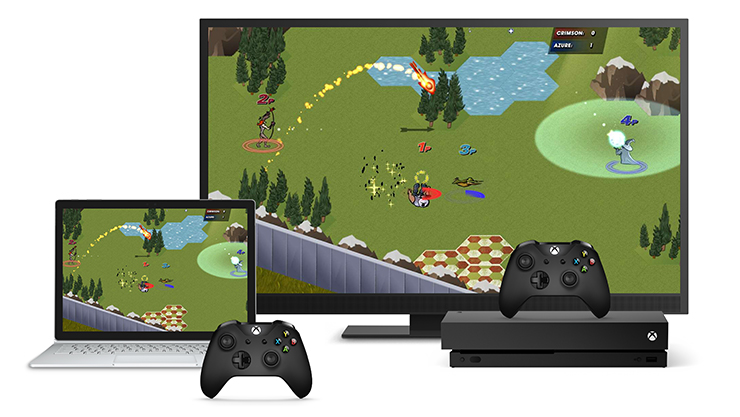 Television and laptop screens showing an Xbox game being tested